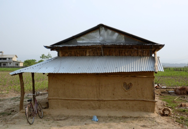 zcow dung house and heart shaped window.JPG
