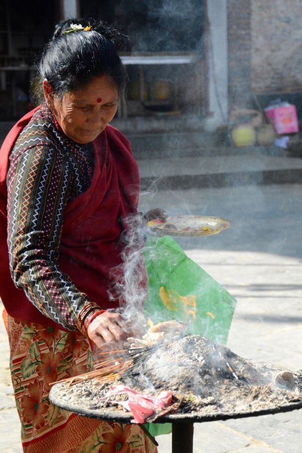 3 Namo Buddha offerings woman